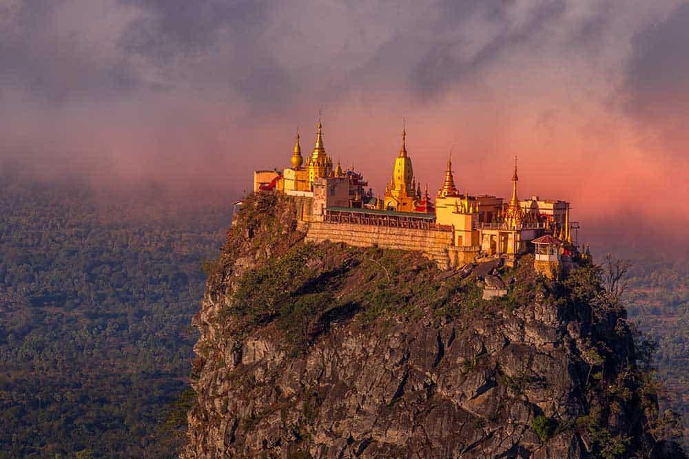 Mount Popa temple, region of new monkeys, shimmers at dusk